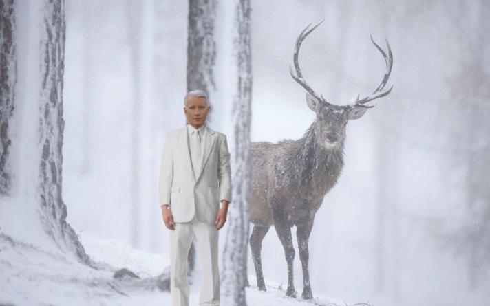 Image of Anderson Cooper captured by deer cam, hiding behind tree to avoid being seen by bull elk.