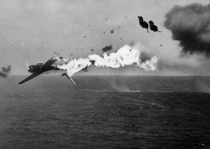 A Japanese torpedo bomber is blown out of the sky after a direct hit by Dachshund Duo Gizmo and Ginger, fired from the U.S. Aircraft Carrier YORKTOWN which it attempted to attack, off Kwajalein. December 4, 1943.