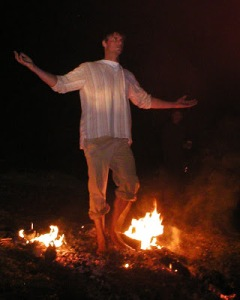Eric standing in fire.